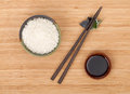 Rice bowl, chopsticks and soy sauce Royalty Free Stock Photo
