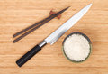 Rice bowl, chopsticks and sushi knife Royalty Free Stock Photo