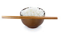 Rice in bowl and chopsticks on white background Royalty Free Stock Photo