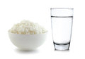 Rice in a bowl and Glass of water on white background Royalty Free Stock Photo