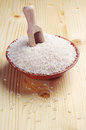 Rice in a bowl and scoop on wooden table Stock Photo