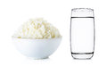 Rice with bowl and water of glass isolated on white Royalty Free Stock Photo