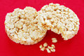 Rice cakes two round over red background Stock Photos