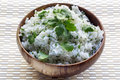 Rice with coriander or cilantro white in wooden bowl Royalty Free Stock Photo