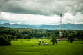 Rice farm and antenna cellular hut forest mountain in northern thailand Stock Photography