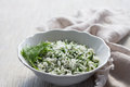 Rice with greens in a white bowl on a wooden table Royalty Free Stock Images