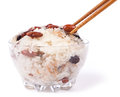Rice with kidney beans and raisins in bowl with chopsticks healthy asian food for holydays Stock Image