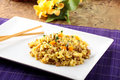 Rice with minced meat and carrots on complex background Stock Photo