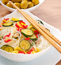 Rice noodles and vegetables on white plate Stock Photos