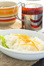Rice pudding dessert topped with orange peel on a white plate Royalty Free Stock Image