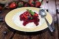 Rice pudding with fruit sauce and mixed fresh fruits Royalty Free Stock Photo