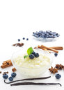 Rice pudding with spices and blueberries Royalty Free Stock Photos
