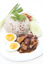 Rice with roasted red pork and egg on white background food Stock Images