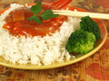 Rice with sweet and sour sauce and broccoli Stock Photos