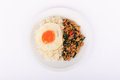 Rice topped with stir fried chicken basil and fried egg fried stir basil with minced chicken on white background isolated Royalty Free Stock Image