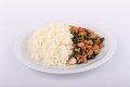 Rice topped with stir fried chicken and basil fried stir basil with minced chicken on white background Stock Photos