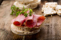 Rice wafers with salami topped and fresh herbs Royalty Free Stock Images