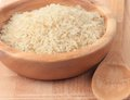 Rice white on wooden bowl Royalty Free Stock Image