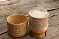 Rice wicker on wooden table Royalty Free Stock Photography