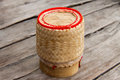 Rice wicker on wooden table Stock Photos