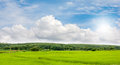 Ricefield and hill of rubber plantation view with beautiful sky background Stock Images
