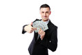 Rich businessman holding us dollars isolated on a white background Stock Photos