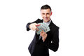 Rich businessman holding us dollars and showing on you isolated on a white background Royalty Free Stock Image