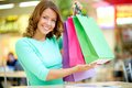 Rich catch smiling young woman boasting of her purchases Stock Images