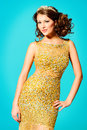Rich lady portrait of a stunning woman in luxurious golden dress Stock Photo