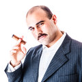 Rich man portrait of a businessman smoking a big cigar isolated over a white background Stock Photos
