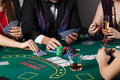 Rich people gambling in casino poker game Royalty Free Stock Images