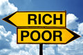 Rich or poor opposite signs two against blue sky background Stock Photos