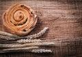 Rich raisin bakery bunch of wheat ears on oak wooden board food Royalty Free Stock Photo