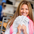 Rich shopping woman smiling holding bunch money Royalty Free Stock Images
