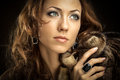 Rich woman the beautiful in furs and jewelry Stock Images