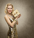 Rich woman with gift box luxury retro girl shining gold dress in yellow golden present for vip lady Stock Photography