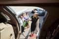 Rich woman with shopping bags che si imbarca su getto privato Immagine Stock Libera da Diritti