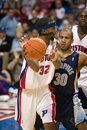 Richard hamilton is guarded by dahntay jones of the detroit pistons during a game against the memphis grizzlies at the the palace Stock Photos