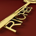 Riches Key Representing Wealth and Treasure Royalty Free Stock Photo