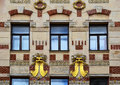 Richly decorated house detail old with windows and rich decorations with masks bricks and gold brno czech republic Royalty Free Stock Photos
