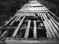 Rickety wooden bridge black and white image of an old in polish countryside Stock Image