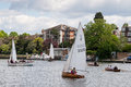 RICMOND, SURREY/UK - MAY 8 : Rowing and sailing on the River Thames between Hampton Court and Richmond on May Royalty Free Stock Photo