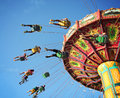 Ride at fair spinning around with people having fun Royalty Free Stock Photo