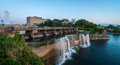 Rideau falls as summer evening approaches lower water levels in spring and provide for a gentle water fall in the city of ottawa Stock Photo