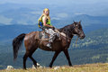 Rider with backpack on horseback Royalty Free Stock Photo