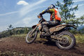 Rider going down a hill dirt and stones from under wheels Stock Photography