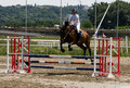 Rider and horse jump over barrier Stock Photos