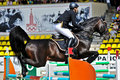 Rider with horse jumps over a hurdle Stock Images