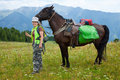 Rider and horse with saddlebags Royalty Free Stock Photography