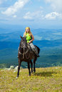 Rider on horseback at mountains Royalty Free Stock Photo